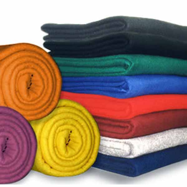 "50"" by 60"" polar fleece blankets in an assortment of colors folded and rolled up"